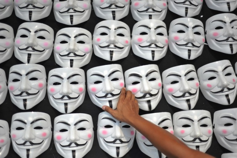 KUALA LUMPUR, MALAYSIA - A Protester choose a Mask during Blackout 505 #KL622 in Kuala Lumpur on Jun 22, 2013. The gathering's three main demands are for the Election Commission (EC) members to step down and a bipartisan interim panel be elected, for re-elections to be held in 30 parliamentary seats which Pakatan lost marginally and claims it has strong proof of misconduct and for the postponement of any delineation or amendments to the election law until a new EC is selected. PHOTO/FIRDAUS LATIF