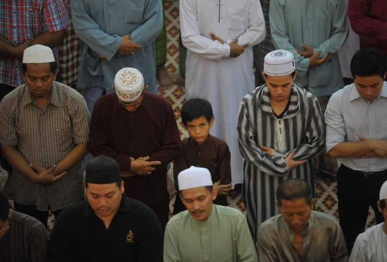 KUALA LUMPUR, MALAYSIA - Malaysian Muslims attend prayers on the eve of the first day of the Islamic fasting month of Ramadan at National Mosque in Kuala Lumpur on july 09, 2013.In Muslim nations and regions around the globe, this is the first week of the holy month of Ramadan, a time for followers to abstain from eating, drinking, smoking and sexual activity during the day, breaking their fast each sunset, with traditional meals and sweets. PHOTO/FIRDAUS LATIF