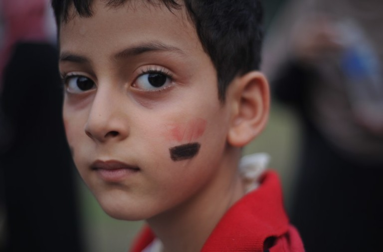 KUALA LUMPUR, MALAYSIA - An Egyptian child face painted with the colours of the Egyptian national flag during a rally to oppose the military overthrow of the Islamist leader and subsequent killings, in Kuala Lumpur on August 17, 2013.Photo by Firdaus Latif