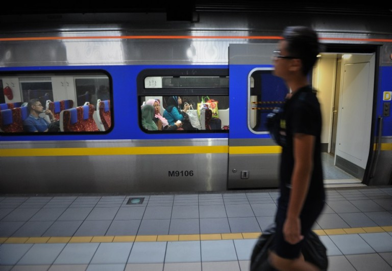 KUALA LUMPUR, MALAYSIA - Passengers sits in a train which will take them to their home villages for the August 8 Eid al Fitr holiday in Kuala Lumpur on August 6, 2013. In the days ahead of the Eid al Fitr holiday, millions of Malaysian working in Kuala Lumpur return to their hometowns to celebrate the holiday with family.Photo by Firdaus Latif