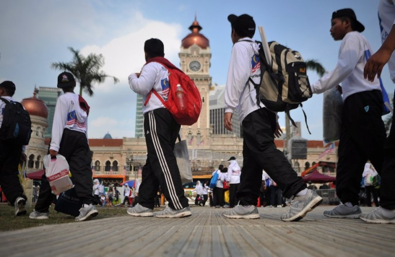 Participants walk past The Sultan Abdul Samad Building after rehearsal during Preparation for Malaysia independence day in Kuala Lumpur on August 26, 2013.Hari Merdeka (Independence Day) is a national day of Malaysia commemorating the independence of the Federation of Malaya from British colonial rule in 1957, celebrated on August 31 each year. Malay Mail/Firdaus Latif