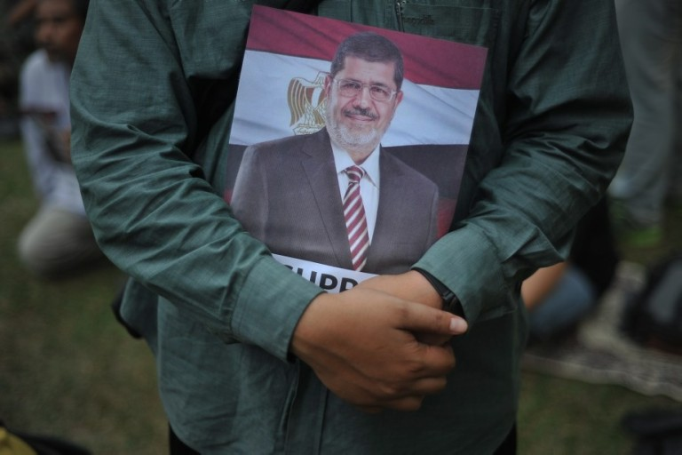 KUALA LUMPUR, MALAYSIA - A Malaysian Islamist holds a poster of ousted Egyptian President Mohamed Morsi during a rally to oppose the military overthrow of the Islamist leader and subsequent killings, in Kuala Lumpur on August 17, 2013.Photo by Firdaus Latif