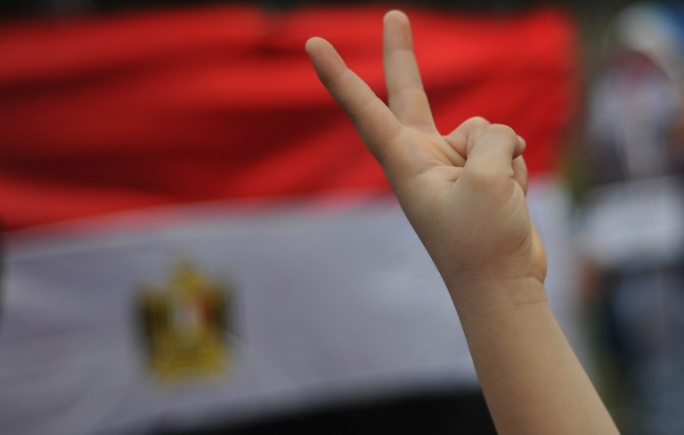 KUALA LUMPUR, MALAYSIA - An Egyptian show his fingers during a rally to oppose the military overthrow of the Islamist leader and subsequent killings, in Kuala Lumpur on August 17, 2013.Photo by Firdaus Latif