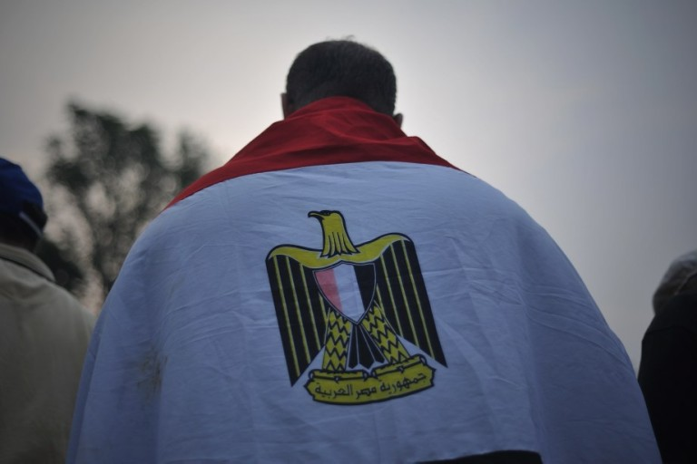 KUALA LUMPUR, MALAYSIA - A Egyptian wrapping his body with Egypt national flag during a rally to oppose the military overthrow of the Islamist leader and subsequent killings, in Kuala Lumpur on August 17, 2013.Photo by Firdaus Latif