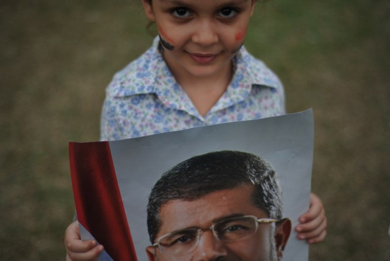 KUALA LUMPUR, MALAYSIA - An Egyptian child holds a poster of ousted Egyptian President Mohamed Morsi during a rally to oppose the military overthrow of the Islamist leader and subsequent killings, in Kuala Lumpur on August 17, 2013.Photo by Firdaus Latif