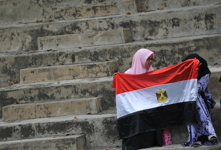 KUALA LUMPUR, MALAYSIA - Malaysian Islamist holds a Egypt flag during a rally to oppose the military overthrow of the Islamist leader and subsequent killings, in Kuala Lumpur on August 17, 2013.Photo by Firdaus Latif