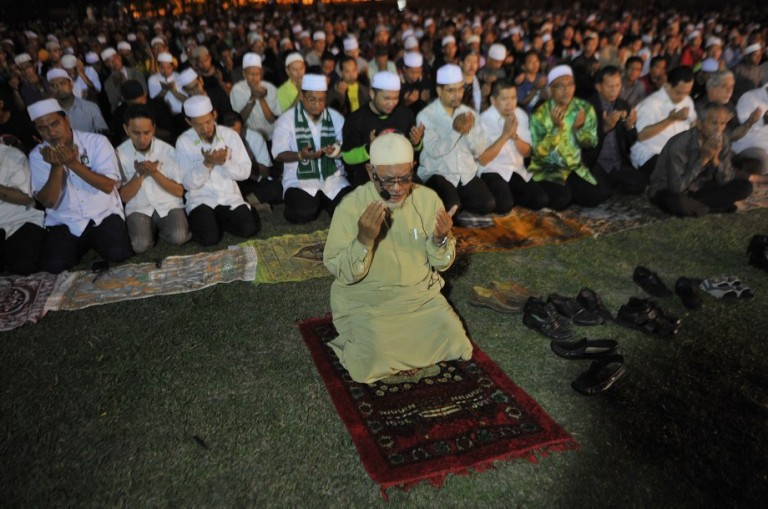 "KUALA LUMPUR, MALAYSIA - Malaysian Muslims offer special prayers called ""Qunut Nazilah"" during a rally to oppose the military overthrow of the Islamist leader and subsequent killings, in Kuala Lumpur on August 17, 2013.Photo by Firdaus Latif"