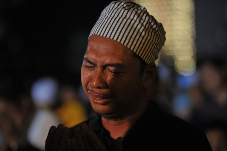 "KUALA LUMPUR, MALAYSIA - Malaysian Muslims cries after offer special prayers called ""Qunut Nazilah"" during a rally to oppose the military overthrow of the Islamist leader and subsequent killings, in Kuala Lumpur on August 17, 2013.Photo by Firdaus Latif"