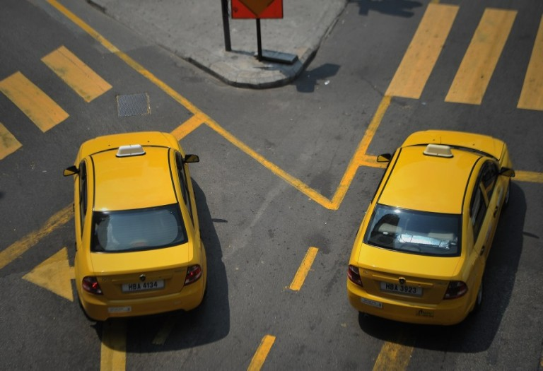 Taxis wait for a traffic light to turn green n Kuala Lumpur, Malaysia, 23 September 2013. Photo by Firdaus Latif