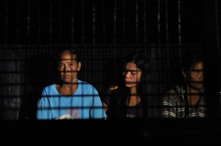Illegal foreign workers sits in an immigration truck during an immigration raid operation shortly after midnight in Klang, outside Kuala Lumpur on September 1 2013. Malay Mail/Firdaus Latif