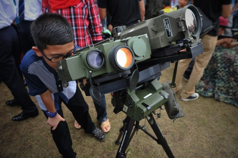 A boy looking through a Malaysian Armed Forces Binocular Techinal Data during last day the Armed Forces 80th Anniversary celebration in Kuala Lumpur, Malaysia, 22 September 2013. Photo by Firdaus Latif