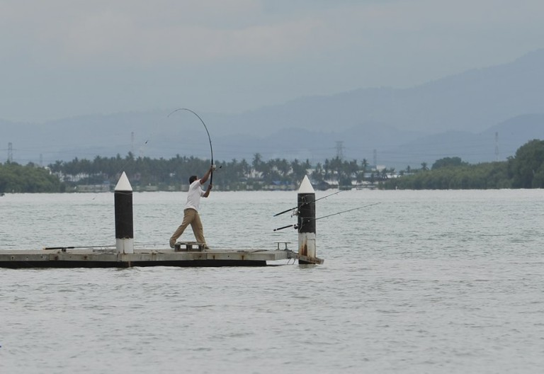 A man fishing at Pulau Aman in Penang on October 5, 2013. Photo by Firdaus Latif