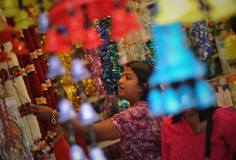 An Indian women browses home decorations ahead of the upcoming Diwali festival celebrations  at the Brickfields area, also known as Little India in Kuala Lumpur, Malaysia on October 29, 2013.  Photo: Firdaus Latif