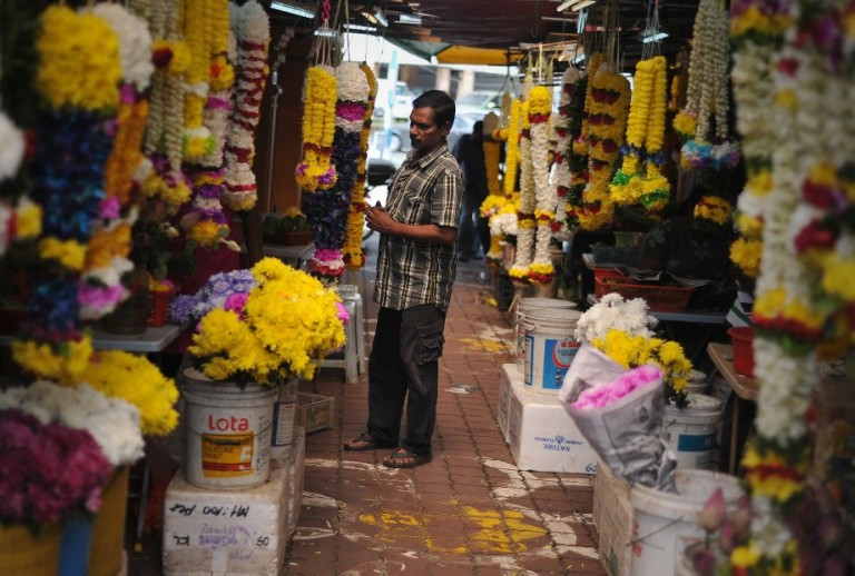 An Indian man browses home decorations ahead of the upcoming Diwali festival celebrations  at the Brickfields area, also known as Little India in Kuala Lumpur, Malaysia on October 29, 2013.  Photo: Firdaus Latif