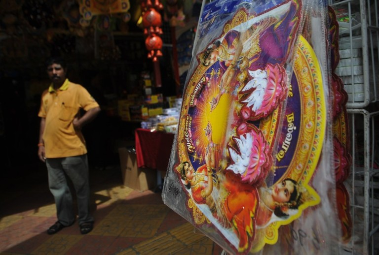 A vendors waiting for costumer during ahead of the upcoming Diwali festival celebrations  at the Brickfields area, also known as Little India in Kuala Lumpur, Malaysia on October 29, 2013.