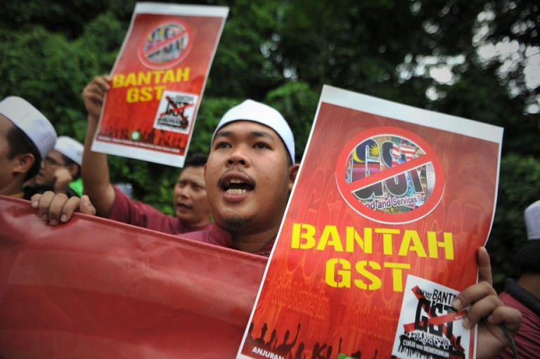 A protester shout slogans during a protest as they gather in front of Parliament House in Kuala Lumpur, Malaysia on October 25, 2013.Malaysia will finally implement the long-delayed Goods and Services Tax (GST) at 6 per cent beginning April 2015, during Prime Minister Datuk Seri Najib Razak announced the Budget 2014. Photo: Firdaus Latif