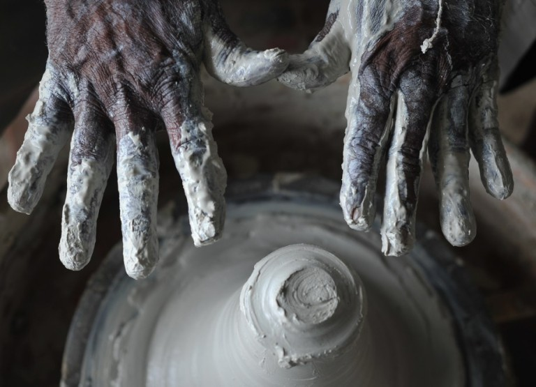 A potter hand with earthenware at his workshop in Kuala Selangor outside Kuala Lumpur, Malaysia on October 26, 2013. Pottery is the ceramic material which makes up potterywares, of which major types include earthenware, stoneware and porcelain. Pottery also refers to the art or craft of a potter or the manufacture of pottery.  Photo: Firdaus Latif