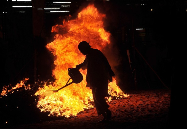 A Malaysian Chinese devotee burns charcoal during the Chinese Nine Emperor Gods Festival in Kuala Lumpur on October 13, 2013. The nine-day Taoist festival, believers welcome the Òemperor godsÓ who they believe live amongst the stars, in order to bring good fortune, longevity and good health. Some devotees stay at a temple during the festival, which begins on the eve of the ninth lunar month of the Chinese calendar, where they consume vegetarian meals and recite continuous prayers Photo: Firdaus Latif