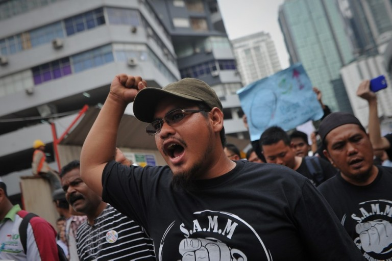 A protester shout slogans during a protest against the Trans-Pacific Partnership Agreement (TPPA) in Kuala Lumpur on October 11, 2013. Activists protested outside the Global Entrepreneurship Summit. Photo: Firdaus Latif