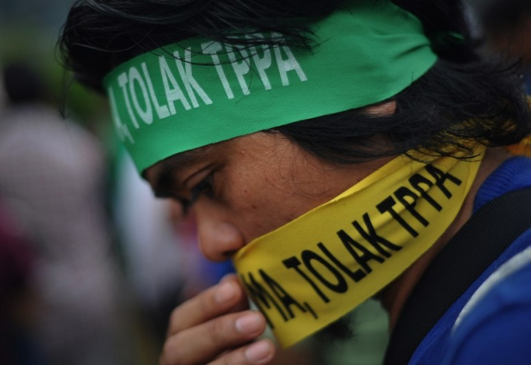 """A protester wears a headband reading """"no TPPA"""" during a protest against the Trans-Pacific Partnership Agreement (TPPA) in Kuala Lumpur on October 11, 2013. Activists protested outside the Global Entrepreneurship Summit. Photo: Firdaus Latif"""