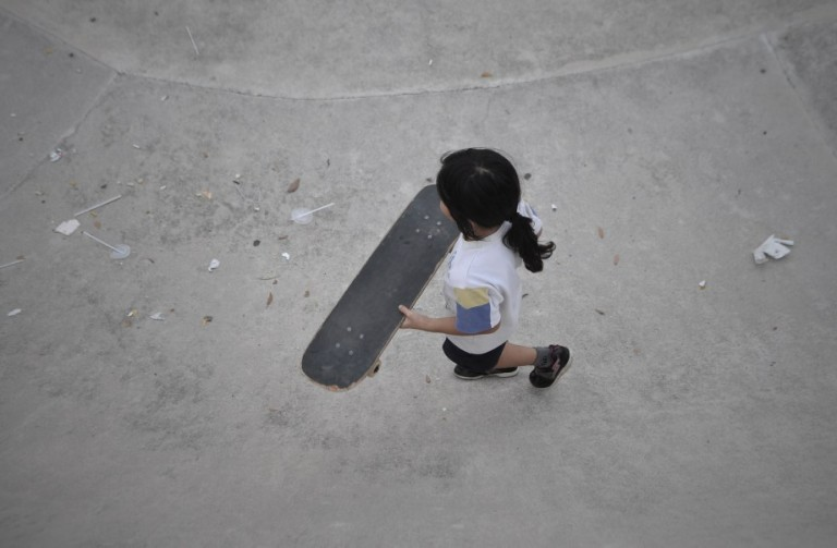A young girl skateboards in the skate park as they playing extreme sports during school holiday at Shah Alam. Photo by Firdaus Latif