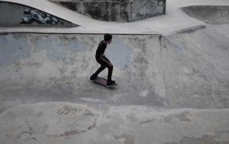 A young boy skateboards in the skate park as they playing extreme sports during school holiday at Shah Alam. Photo by Firdaus Latif