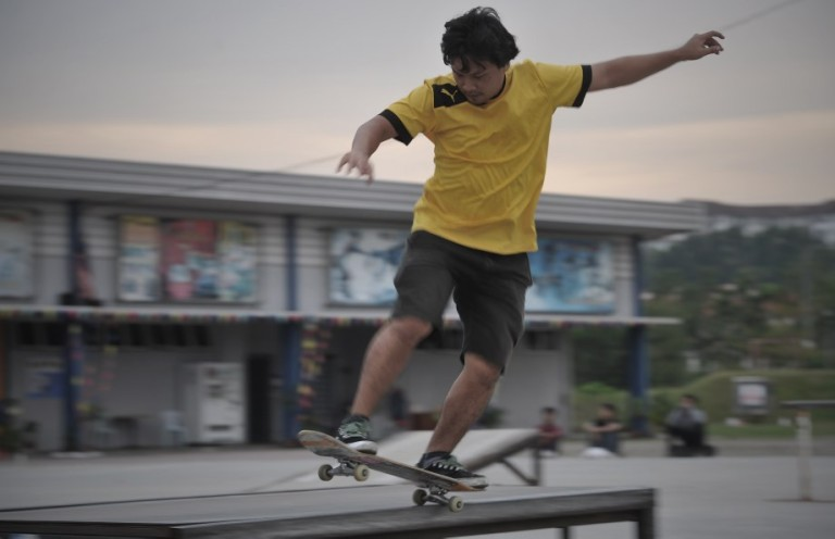 A man skateboards in the skate park as they playing extreme sports during school holiday at Shah Alam. Photo by Firdaus Latif