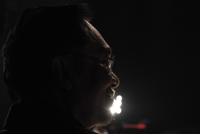 KUALA LUMPUR, MALAYSIA -Malaysian opposition leader Anwar Ibrahim speaks during a protest against recent election in Petaling Jaya on May 25, 2013. Thousands of protesters take part in a rally organized by the opposition to protest  the alleged electoral fraud during the 13th general election held last 05 May 2013. Photo by Firdaus Latif
