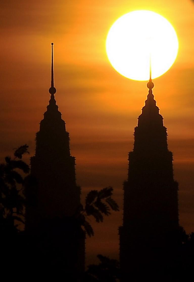 Malaysia's landmark Petronas Twin Towers in silhouette during sunset in Kuala Lumpur 16 Jun 2013.  Photo by Firdaus Latif