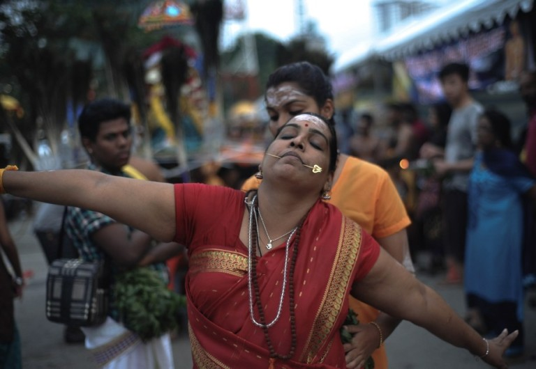 Devotees react as they go into a trance during the Thaipusam procession in Batu Caves, Malaysia on January 17, 2014. Photo by Firdaus Latif
