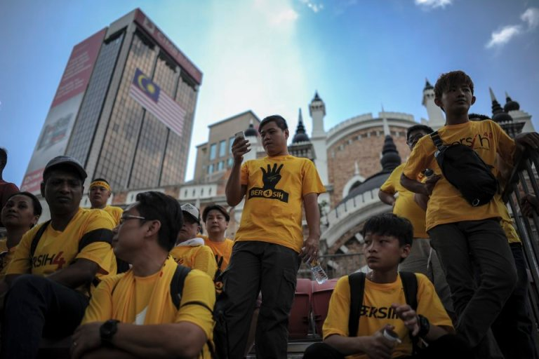 A protester checks his mobile phone during  BERSIH 4.0 (The Coalition for Free and Fair Elections) in Kuala Lumpur on August 29, 2015. Photo by Firdaus Latif