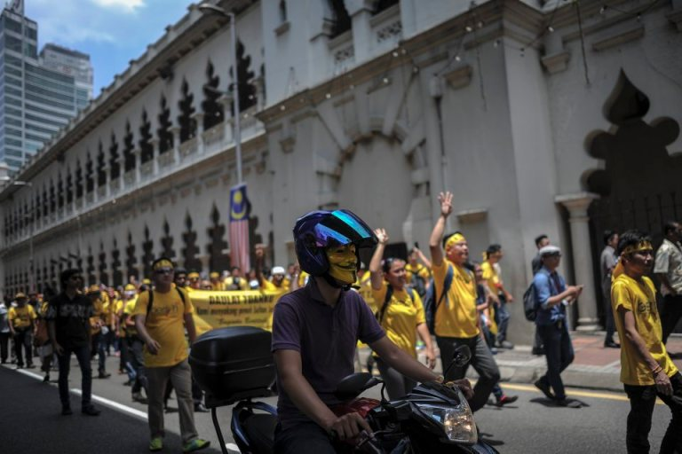 A protesters rides a bike with a mask during BERSIH 4.0 (The Coalition for Free and Fair Elections) in Kuala Lumpur on August 29, 2015. Photo by Firdaus Latif
