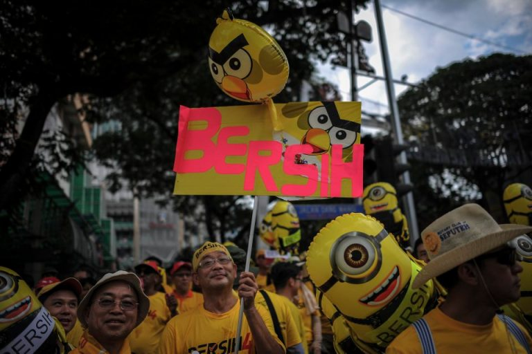 A protestor holds up a mascot with a sign that reads 'Bersih', which means clean in the Malay language during BERSIH 4.0 (The Coalition for Free and Fair Elections) in Kuala Lumpur on August 29, 2015. Photo by Firdaus Latif
