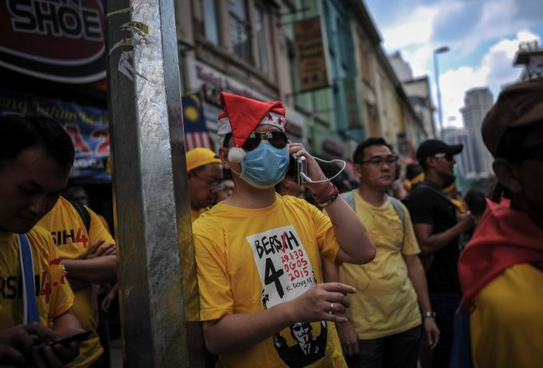 A protester wearing a Santa Claus hat during BERSIH 4.0 (The Coalition for Free and Fair Elections) in Kuala Lumpur on August 29, 2015. Photo by Firdaus Latif