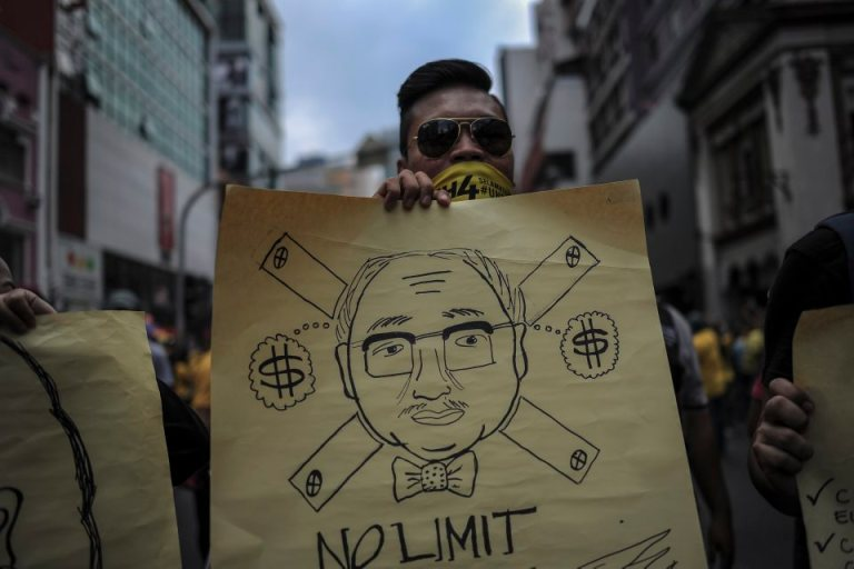 A protester display placards during BERSIH 4.0 (The Coalition for Free and Fair Elections) in Kuala Lumpur on August 29, 2015. Photo by Firdaus Latif