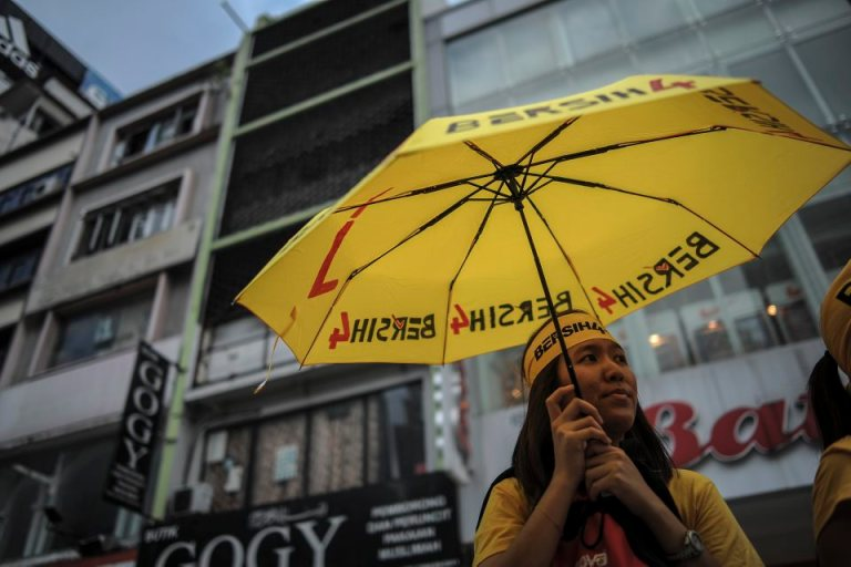 A protester holds a yellow umbrella during a BERSIH 4.0 (The Coalition for Free and Fair Elections) in Kuala Lumpur on August 29, 2015. Photo by Firdaus Latif