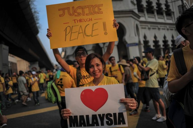 Protestors display placards during BERSIH 4.0 (The Coalition for Free and Fair Elections) in Kuala Lumpur on August 29, 2015. Photo by Firdaus Latif