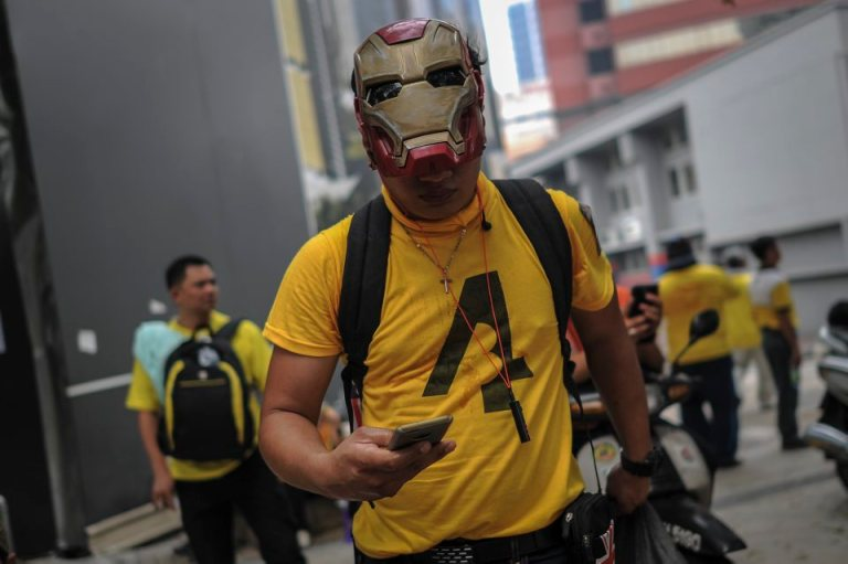 A protester wears an Ironman mask during BERSIH 4.0 (The Coalition for Free and Fair Elections) in Kuala Lumpur on August 30, 2015. Photo by Firdaus Latif
