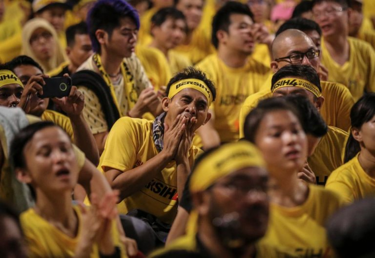 A protester yawns while amongst thousands of protestors seated along the streets during BERSIH 4.0 (The Coalition for Free and Fair Elections) in Kuala Lumpur on August 30, 2015. Photo by Firdaus Latif