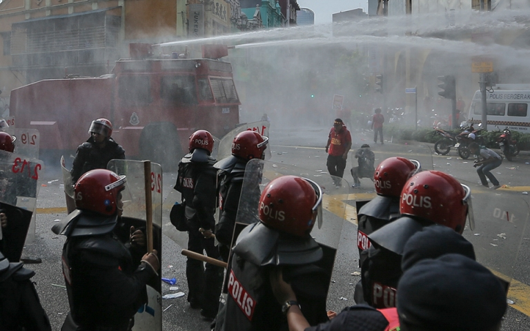 Malaysian Police Anti Riot Squad FRU fire water cannon at protestors during a pro-government Red Shirts rally in Kuala Lumpur on September 16, 2015. PHOTO BY FIRDAUS LATIF