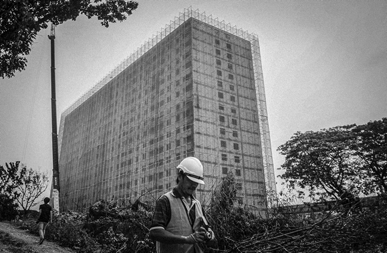 A Workers make preparations for the demolition of Pekeliling Flats after The Kuala Lumpur City Hall (DBKL) has set a two-year period, to demolish the remaining five blocks of the Tunku Abdul Rahman Flats, better known as Pekeliling Flats in Jalan Tun Razak. PHOTO BY FIRDAUS LATIF