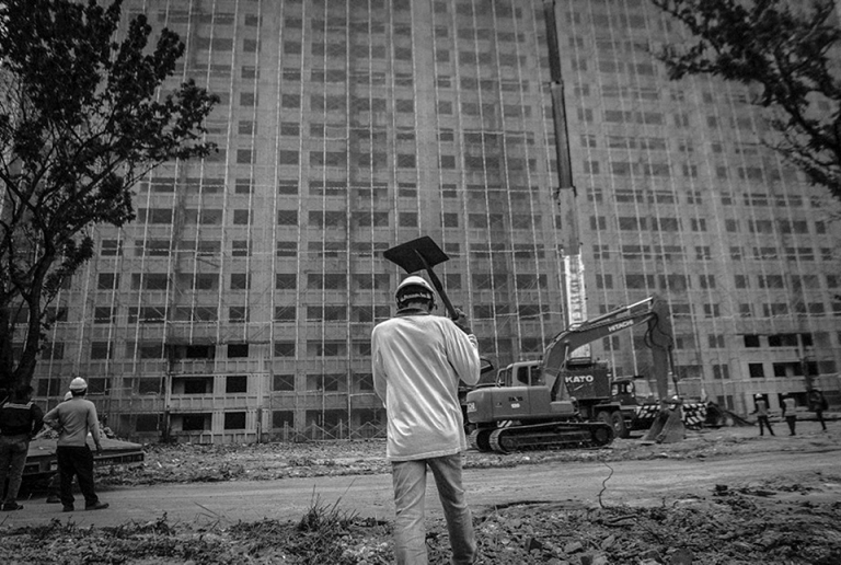 A Workers carry shovels before the demolition of Pekeliling Flats after The Kuala Lumpur City Hall (DBKL) has set a two-year period, to demolish the remaining five blocks of the Tunku Abdul Rahman Flats, better known as Pekeliling Flats in Jalan Tun Razak. PHOTO BY FIRDAUS LATIF