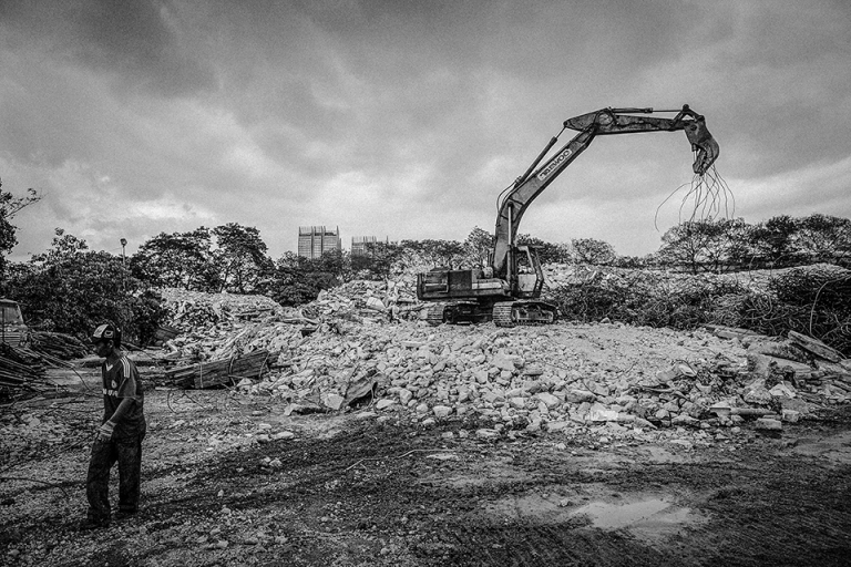 An excavator is used to demolish a building of Pekeliling Flats after The Kuala Lumpur City Hall (DBKL) has set a two-year period, to demolish the remaining five blocks of the Tunku Abdul Rahman Flats, better known as Pekeliling Flats in Jalan Tun Razak. PHOTO BY FIRDAUS LATIF
