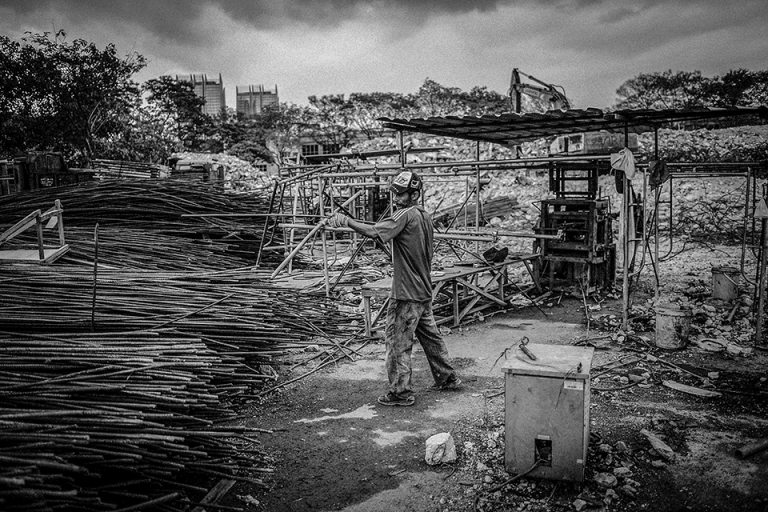 A Workers collect steel bars for recycling as they demolish a building of Pekeliling Flats after The Kuala Lumpur City Hall (DBKL) has set a two-year period, to demolish the remaining five blocks of the Tunku Abdul Rahman Flats, better known as Pekeliling Flats in Jalan Tun Razak. PHOTO BY FIRDAUS LATIF